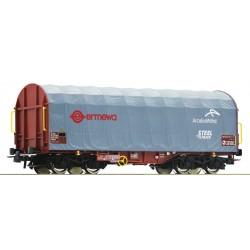 Wagon bâché à bogies Ermewa ArcelorMittal Ep V à l'échelle HO (1/87) fabriqué par Roco. Longueur 138 mm, tampons compris.